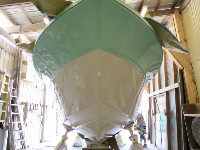All previous anti-fouling removed. The custom color application is completed on the hull.