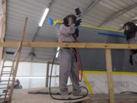 James Chamberlain readies to lay on the first layer of Awlgrip HDT topcoat